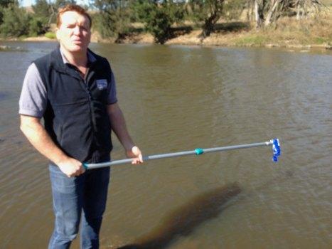 Damon with water sampling pole